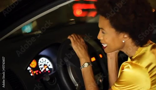 African American woman in car talking on cell phone