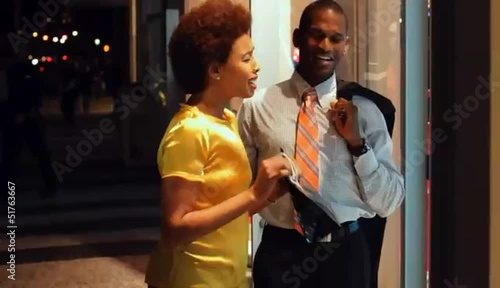 African American couple window shopping
