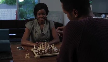 Couple at home playing chess