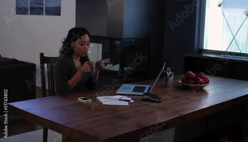 African American woman at home working with laptop