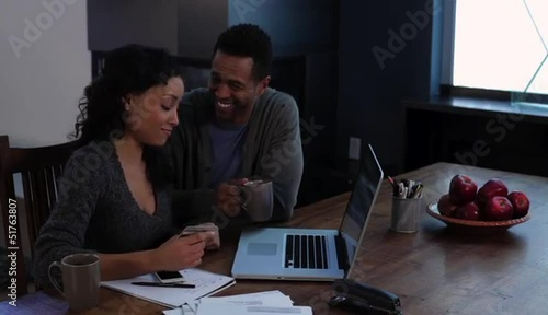 Couple using credit card and having fun at laptop