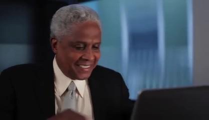 Senior businessman arriving at laptop to work