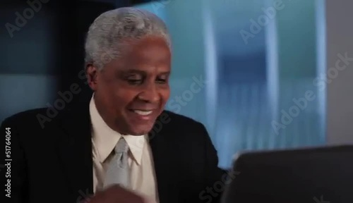 Senior businessman arriving at laptop to work