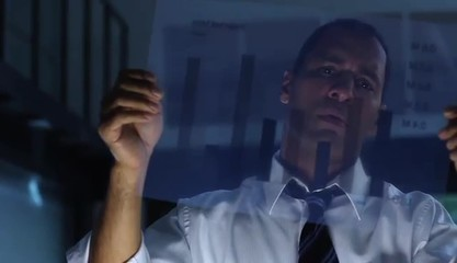 Businessman analyzing transparency graph in office