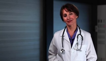 Smiling doctor wearing stethoscope