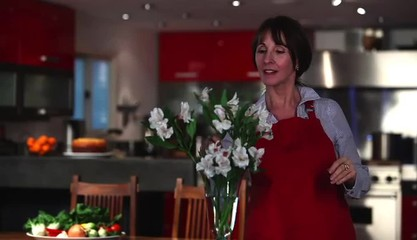 Woman in upscale home arranging fresh flowers