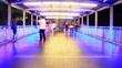 People walking on skywalk at night , time lapse