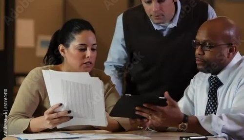 Business people looking at digital tablet together