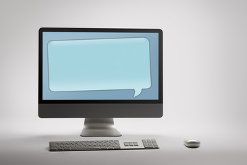 Desktop computer with blank speech bubble