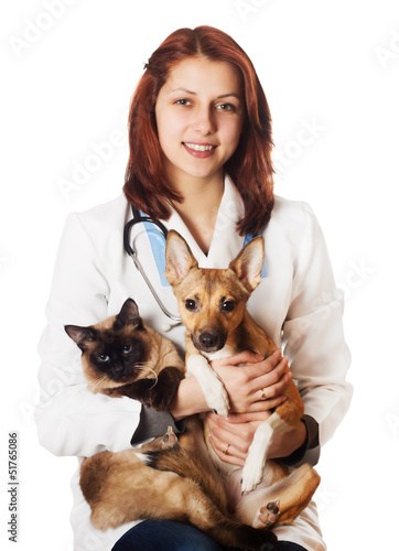 Woman vet with pets on a white background isolated