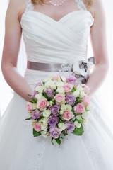 Brides bouquet and dress detail