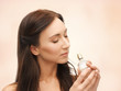 woman smelling perfume