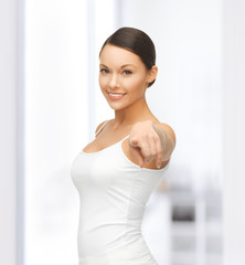 woman in blank white t-shirt pointing at you