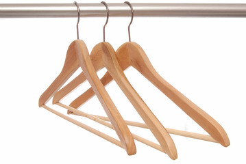 Empty wooden hangers are on white background.