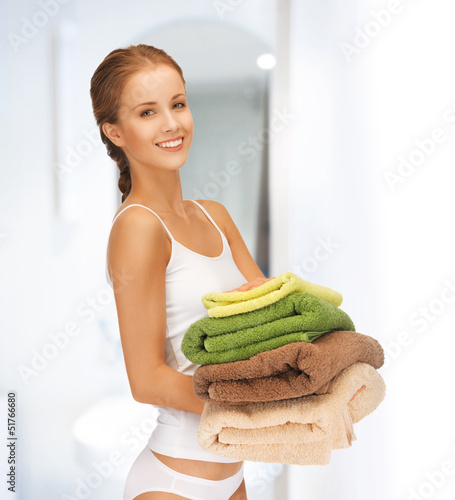 lovely housewife with towels