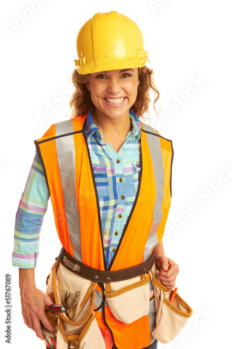 Happy beautiful female construction worker