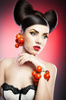 Portrait of sensual woman model with luxury makeup with tomatoes