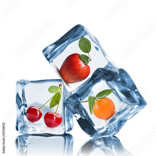 fruits in ice cubes isolated on white
