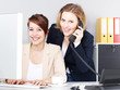 Two business women work in the office