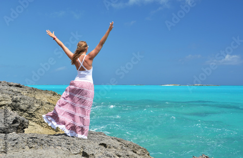 Girl on the rock looking to Atlantic. Little Exuma, Bahamas
