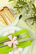 Table setting in white and green tones