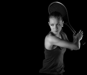 Female tennis player with racket ready to hit
