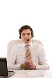 Handsome businessman wearing a headset