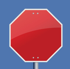 Blank stop sign on a gradient blue sky