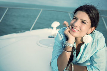 Thoughtful woman in a yacht