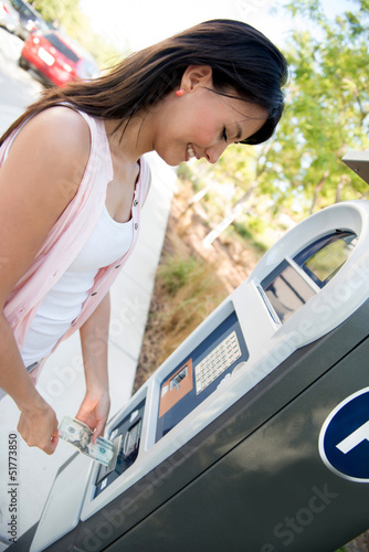 Woman paying for parking