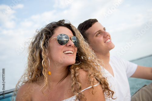 Mother and son sailing on a boat