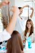 Happy woman cutting her hair