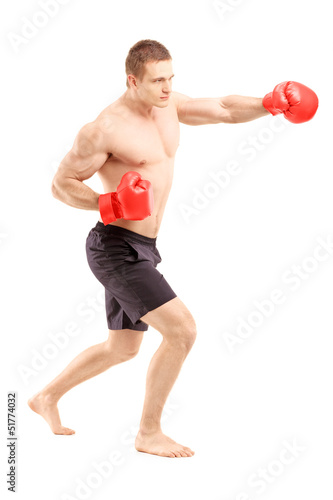 Full length portrait of an athlete with boxing gloves