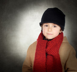 Beautiful child with scarf and wool hat