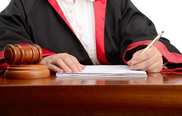 Female judge writing the verdict isolated on white background