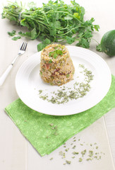 Brown rice with green peas and prosciutto