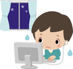 夜にパソコンに熱中する男の子