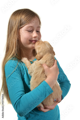 Girl holding a golden retriever pup