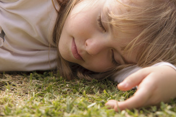 Little Girl Sleeping on Grass