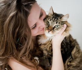 beautiful smiling brunette girl and her  cat over