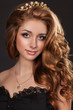 Fashion brunette woman with perfect curly hair