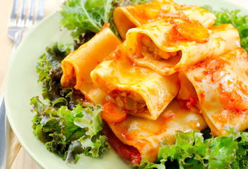 pasta with sauce and salad