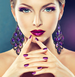 Purple makeup and manicure.