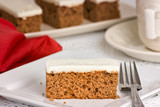 Carrot Cake on a white plate with fork. Shallow depth of field