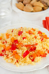 couscous with vegetables on white plate