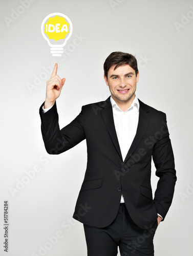 Business man with an idea bulb