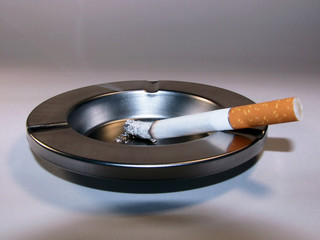 Cigarette and ashtray