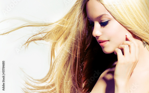 Beauty Blond Girl With Long Healthy Blowing Hair