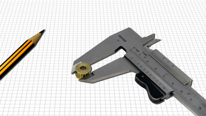 Calibro e matita su foglio a quadretti