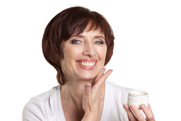 mature woman with facial cream